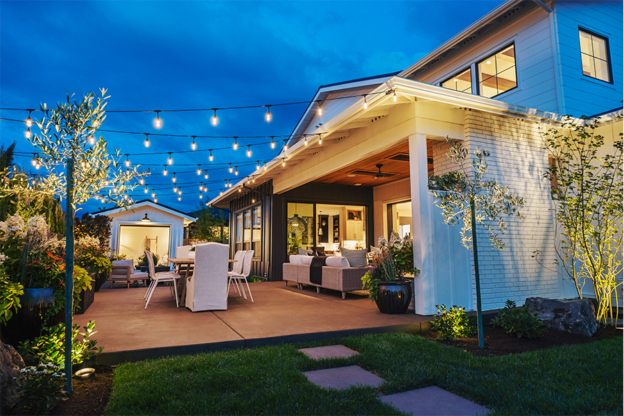 String lights over patio at night