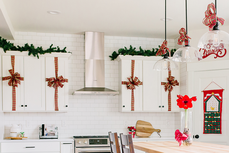 Heritage Market Kitchen Island Pendants Decorated with Red Bows for Christmas