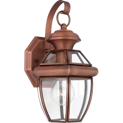 Quoizel Lighting Outdoor Wall Light with Clear Glass in Aged Copper Finish NY8315AC