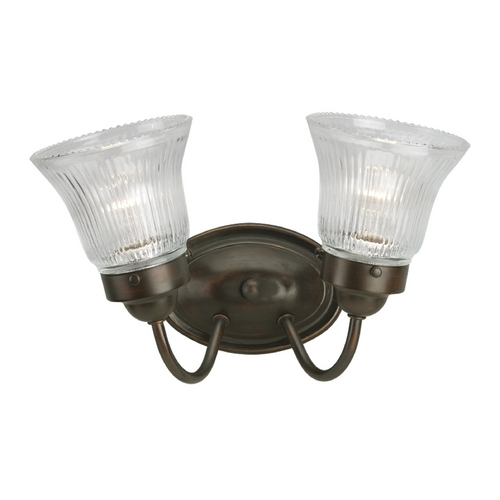 Progress Lighting Progress Bathroom Light with Clear Glass in Antique Bronze Finish P3288-20