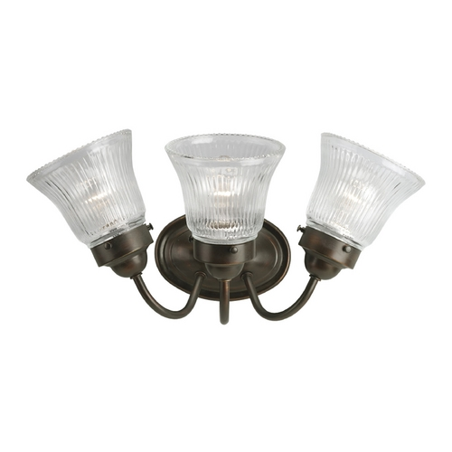 Progress Lighting Progress Bathroom Light with Clear Glass in Antique Bronze Finish P3289-20
