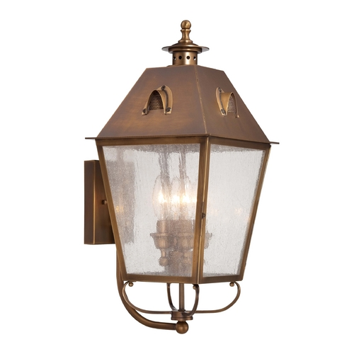 Minka Lavery Outdoor Wall Light with Clear Glass in English Brass Finish 72423-212
