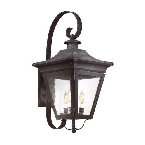 Troy Lighting Outdoor Wall Light with Clear Glass in Natural Rust Finish BCD8933NR