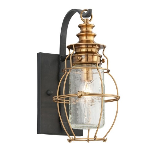 Troy Lighting Outdoor Wall Light with Clear Cage Shade in Aged Brass / Forged Black Finish B3571