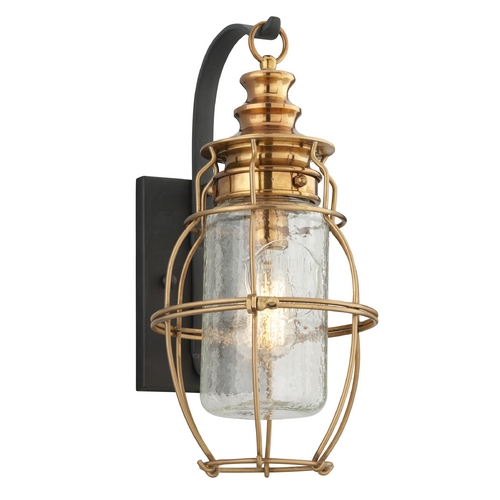 Troy Lighting Outdoor Wall Light with Clear Cage Shade in Aged Brass / Forged Black Finish B3572