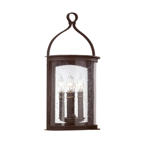 Troy Lighting Outdoor Wall Light with Clear Glass in Forged Black Finish B9472FBK