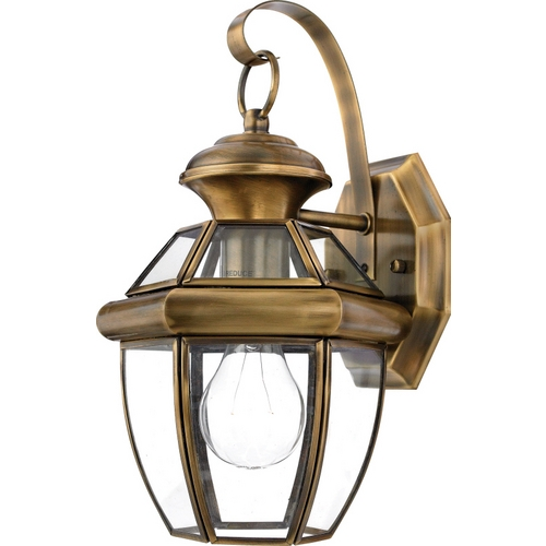 Quoizel Lighting Outdoor Wall Light with Clear Glass in Antique Brass Finish NY8315A