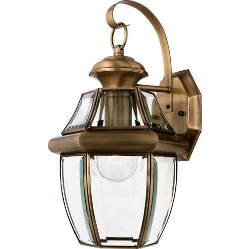 Quoizel Lighting Outdoor Wall Light with Clear Glass in Antique Brass Finish NY8316A