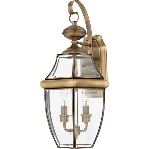 Quoizel Lighting Outdoor Wall Light with Clear Glass in Antique Brass Finish NY8317A