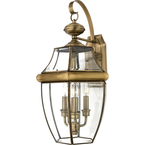 Quoizel Lighting Outdoor Wall Light with Clear Glass in Antique Brass Finish NY8318A