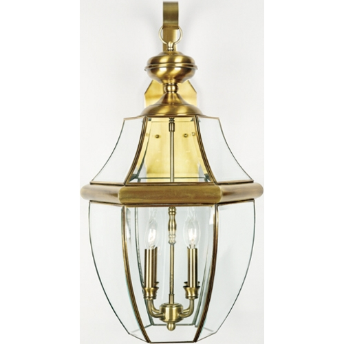Quoizel Lighting Outdoor Wall Light with Clear Glass in Antique Brass Finish NY8339A