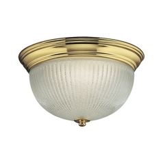 Progress Flushmount Light with Clear Glass in Polished Brass Finish