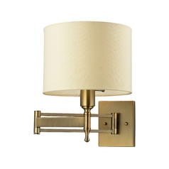 Swing Arm Lamp with Beige / Cream Shade in Antique Brass Finish