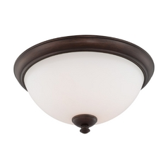 Flushmount Light with White Glass in Prairie Bronze Finish