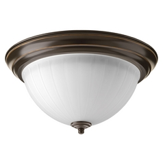 LED Flushmount Light with White Glass in Antique Bronze Finish