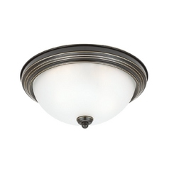 Flushmount Light with White Glass in Heirloom Bronze Finish