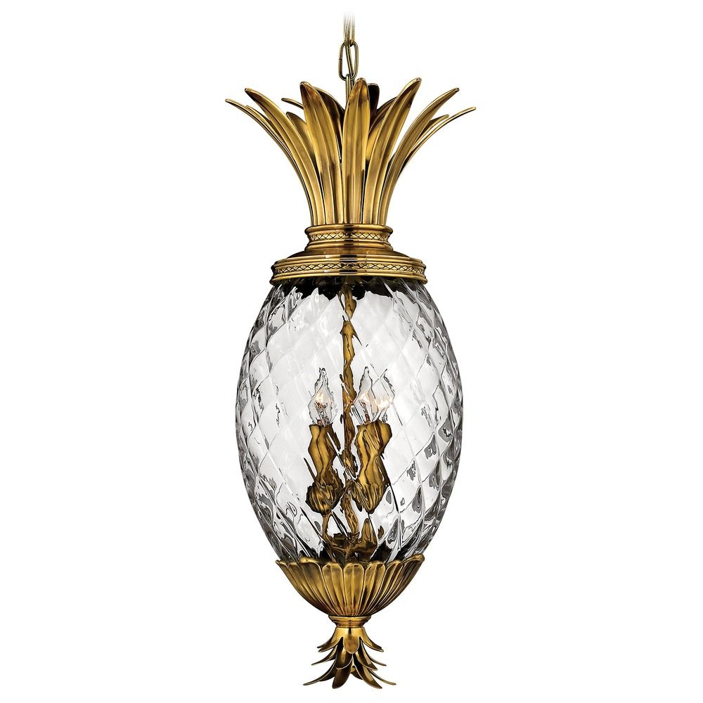 Burnished brass pineapple outdoor hanging light with clear glass at destination lighting