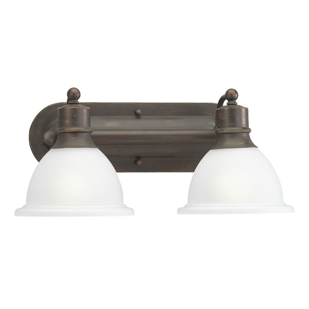 Progress bathroom light with white glass in antique bronze for Bathroom light fixtures brass finish