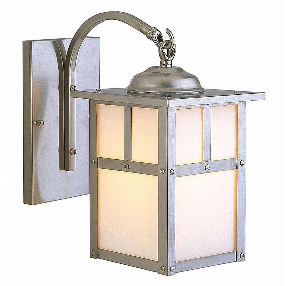 mission style outdoor wall light with white glass
