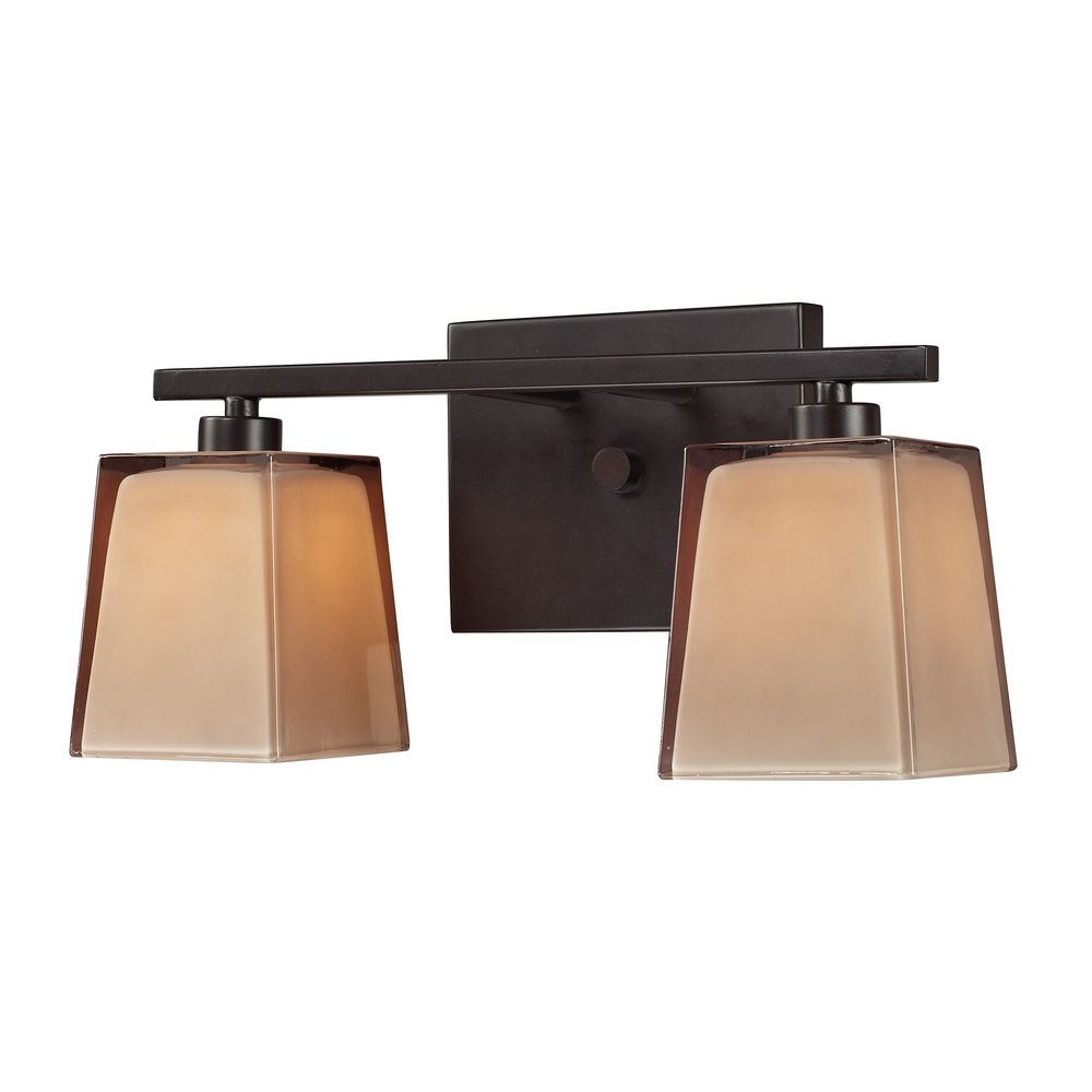 Bathroom light with brown glass in oiled bronze finish for Bathroom light fixtures brass finish